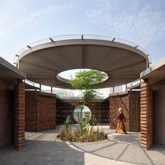 Tree grows through courtyard of Casa UC by Daniela Bucio Sistos.