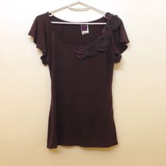3/$15 Brown appliqué flower top Brown scoopneck top with flower appliqués along the neckline! Size S. Flowers show some wear (as shown), but otherwise the top is in great condition. Priced accordingly. Buy this for only $1 when added to a bundle! Wrapper Tops Tees - Short Sleeve