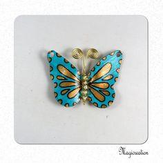 breloque papillon vinyle turquoise et doré 4.5 cm