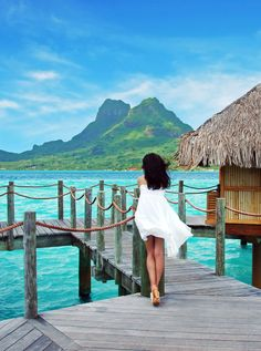 Beautiful woman stands alone at Bora Bora island, French Polynesia