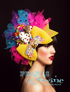 Extravaganza – Eccentric Circus Inspired Headpiece, Flamboyant, Crazy, Weird, Unusual, Vibrant, Multi Coloured, OTT, Giant Bow,  Clown Face, Glitter, Sparkly, Seal, Lion, Wearable Art, One of a Kind, Occasion Wear, Royal Ascot, Statement Piece, Pearls and Swine, Pearls & Swine, British Milliner, Avant Garde Millinery, Accessories Designer, Zany, Unique, Surreal Headwear, Bizarre, Fabulous