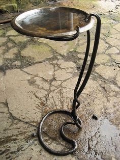 Contemporary birdbath with a hammered brass dish instead of havingit sit on the ground have it STICK INTO the ground