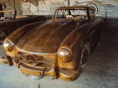 For about $7,000 you could own this hand carved teak Mercedes 300SL. Completely made from wood in exquisite detail. Why someone would do this I don't know, but it's an impressive display of craftsmanship regardless. I can only imagine the hundreds of hours that went into creating this.