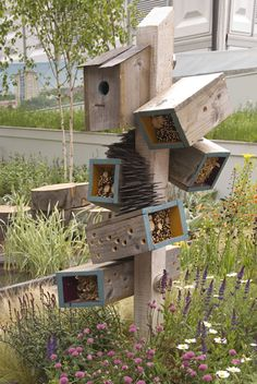 A resting place for those tiny garden visitors - an insect hotel. <like the angled boxes on this one