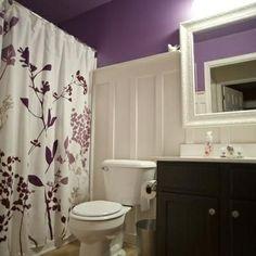 paneled walls to help lighten up the room with the dark vanity