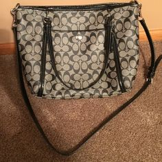 Coach medium sized purse Black and grey coach logo. Brand new bag, used by my mother for one occasion! You can take the long strap off and use it as more of a large handbag! Coach Bags Shoulder Bags