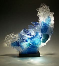 There is something quite extraordinary about sailor and master glass sculptor Caleb Nichols. Fascinated and inspired by the many moods and vastness of the ocean, Caleb artfully blows each unique glass piece and then smashes it with a hammer. Art Of Glass, Blown Glass Art, Fused Glass Art, Glass Wall Art, Glass Ceramic, Mosaic Glass, Diy Resin Crafts, Glass Design, Resin Art