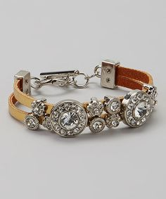 Need that perfect finishing touch? Clasp this pretty piece around the wrist. Artfully combining rugged leather with shimmering rhinestones, this number is the new accessory-drawer necessity.