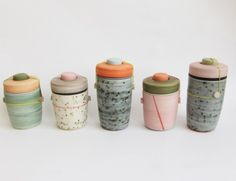 Ben Fiess - what I love about these are both the form (lidded jar) and the mixed media aspect (the rubber bands) ...but what drives me crazy is the glazing (it looks like either salt fire on pigment-dyed clay -OR- someone being very particular about making underglazes look like salt firing...