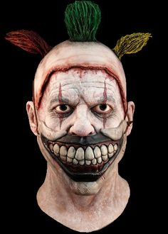 BACK FROM THE GRAVE and 20th Century Fox are proud to present from American Horror Story Freak Show, Twisty the Clown Full Head Deluxe Halloween Mask.  The demented Twisty the Clown was without a doubt the most horrific and scary clown to ever be presented on the screen and now it's your chance to because the ultimate Carnival Freak for Halloween.