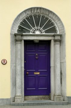 Beautiful... Love all the details and the deep purple of the door...