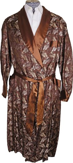 This is a vintage 1950s era dressing gown or lounging robe featuring a woven brocade pattern consisting of abstract leaves in silver and brown against bronze brown background, very 50s era. The fabric