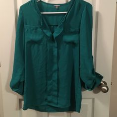 Emerald/Teal Blouse Never worn greenish blouse with alittle bit if a blue tone to it. Stud detailing, 3/4 sleeves, can be worn as a tunic Charlotte Russe Tops Blouses