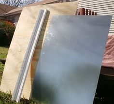 """Giant magnetic board ($7 for 24x36"""" piece of sheet metal + frame = cheapo DIY project)"""