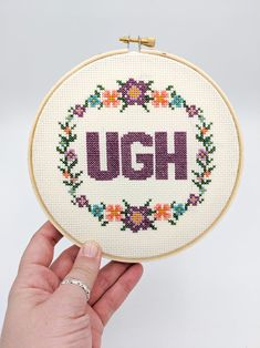 Add some cross stitch to your gallery wall. UGH cross stitch with flowers adds texture and interest to your gallery wall designs Cross Stitch Quotes, Cute Cross Stitch, Cross Stitch Flowers, Cross Stitch Beginner, Cross Stitch Finishing, Funny Cross Stitch Patterns, Cross Stitch Designs, Cross Stitching, Cross Stitch Embroidery
