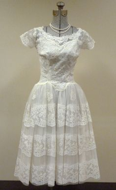 I can remember when I was in 9th grade, we had a special dance, and my dress kind of looked like this! Same style, minus all of the lace!