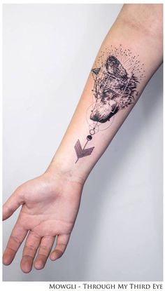'Wolves of Winter', inspired by the song of the same name by Biffy Clyro, on Mary's right inner forearm.
