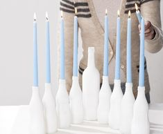 Make one out of spray-painted glass bottles: | 27 Awesome And Unexpected Menorahs