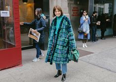 Reese Blutstein in an Esteban Cortazar coat with a Loewe bag.