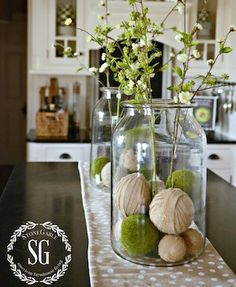SPRING ISLAND JAR VIGNETTE- two big jars with burlap and moss balls at bottom You can find similar great projects and ideas as shown in the picture in our magazine. Decoration Shabby, Rustic Decor, Farmhouse Decor, French Farmhouse, Country Farmhouse, French Country, Spring Home Decor, Diy Home Decor, Kitchen Decorating