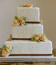 3 tier white square wedding cake with pink sugar roses and white pearls.JPG