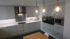 Another beautiful grey Shaker style kitchen designed by Howdens in Blandford. The pendant lighting makes a great focal point, for more kitchen inspiration visit Howdens.