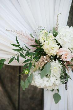 Floral tie-backs // photo by Jennie Andrews + florals by Samuel Franklin #weddingflorals #southernwedding #castletonfarms