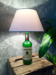 Jameson whiskey bottle lamp  1 Litre  This lamp has been up-cycled by myself.  Makes a quirky present, or just something for yourself.    A hole