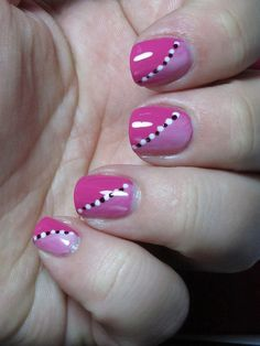 White stripe with black dots breaking up the pink nails. - DIY Nail Art Designs