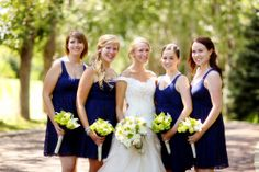 navy blue bridesmaid dresses, green and white bouquets. Always a classy, elegant color scheme.