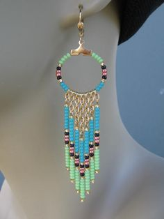 SALE! Was $16... now $12.50!  These beauties are made with opaque aqua, opaque lime green, metallic copper, opaque black, & golden seed beads, with