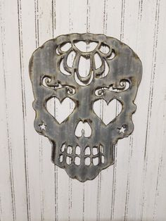 This is a Vintage Style Up-cycled old Corrugated Metal Sugar Skull. Has been cut out of old corrugated metal. Measures 11 wide x 15 1/2 tall approx. These are hand made so please allow for slight differences in the metal. No two will be the same. Thank you  LIKE US ON FACEBOOK