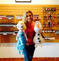 """Emily Seagren, Avon Representative, showing Disney Elsa and Olaf Cuddle Pillows! They are $29.99 each. Elsa sings a selection from """"Let it Go"""" and Olaf has lights that change colors in his belly. Available this Christmas online at http://eseagren.avonrepresentative.com #avon #frozen #elsa #olaf #disney"""