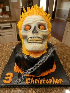 Ghost Rider b-day cake is all vanilla cake, covered in bc icing and fondant w/ fondant/modeling chocolate accents w/ hand painted details.