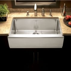 The Epicure Farmhouse Single Bowl Sink by Houzer features 16 and 18-gauge, type 304 stainless steel construction. The farmhouse sink features an 10 inch tall apron with a 2½ inch offset. The kitchen sink is finished in a Brushed Satin and includes strainer and installation kit.