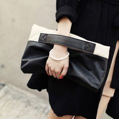 Hand strap clutches are undeniably chic. Wide hand straps set atop mini handbags gives the traditionally formal accessory a cool, downtown vibe. Size: Medium(30-50cm) Exterior includes a Cell Phone po