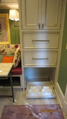 pantry with spot for dog bowls and drawer for food storage