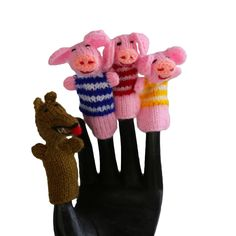 3 Little Pigs Finger Puppet Set of 4 - Fair Trade - #shopfairtrade #fairtrade #thisbluesea  This set of finger puppets is made from wool by a cooperative of women who live high in the Andes mountains of Peru. Each pieces is approximately 3 inches tall.  Meet the Artisans  Global Handmade Hope began in 2009 after a trip to Rwanda. With the mission is to promote social justice, help families provide food, shelter, education and gain access to health care. They accomplish this goal by offering…