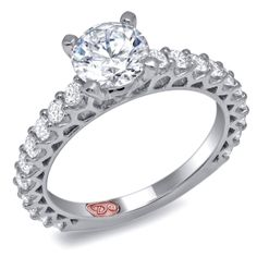Designer Engagement Rings from DemarcoJewelry.com  Available in White or Yellow Gold 18KT and Platinum. 0.68 RD  Capture her grace and endless beauty with this confident yet elegant design. We have also incorporated a unique pink diamond with every single one of our rings, symbolizing that hidden, unspoken emotion and feeling one carries in their heart about their significant other.  This is not just another ring, this is a heirloom piece of jewelry.  Demarco Bridal Engagement…