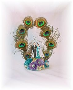 Peacock wedding cake topper  Follow Us: www.jevelweddingplanning.com www.facebook.com/jevelweddingplanning/ https://plus.google.com/u/0/105109573846210973606/ www.twitter.com/jevelwedding/