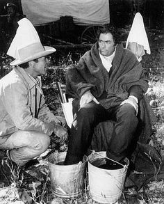 "Robert Preston and Gregory Peck on the set of ""How the West Was Won"""