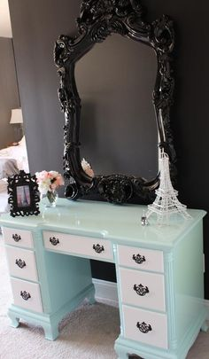 Stunning vanity with black chunky mirror. I would paint the dresser part all one color though (a brighter Tiffany blue)