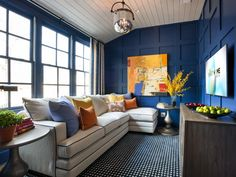 Bathed in blue, the upstairs gathering space offers a spot to relax, watch television, and play games.