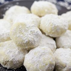 These delicious Greek holiday cookies, know as Kourambiethes or Kourabiedes (Greek Christmas Butter Cookies), are covered in powdered sugar, easy cookies to make, and something the whole family will love this holiday season. Greek Sweets, Greek Desserts, Köstliche Desserts, Greek Recipes, Delicious Desserts, Dessert Recipes, Yummy Food, Milk Recipes, Greek Cookies