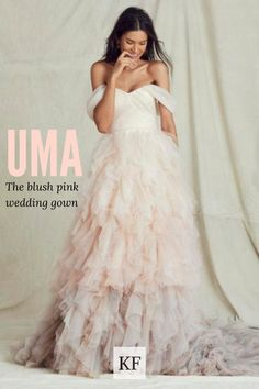 Standing at the peak of bridal color and passion, this dynamic tiered tulle wedding dress is a free-spirited romp of bold color. Carefree off-the-shoulder straps inject a forward-looking thrill into the contemporary cool of the blush pink wedding gown. The bountiful layers of the cotton-candy tulle skirt skate from blush into blue. Check out our wedding dress selection for the very best design and experience. #wedding #weddinginspiration #weddingday #beauty #thatsdarling Pink Wedding Gowns, Blush Pink Weddings, Tulle Wedding, Tulle Balls, Tulle Ball Gown, Ball Gowns, Strapless Dress Formal, Formal Dresses, Blue Check