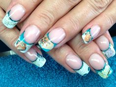 Turquoise and postcard nail design