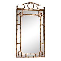 """We love this Chinoiserie bamboo gold mirror. It is perfect for over a chest or a console table. This is our new favorite mirror! Dimensions: 42"""" H x 21""""W Materials: Iron and Glass"""