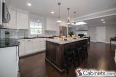 Love the open floor plan and bright white cabinets! Shown are our Deerfield Shaker Maple Bright White assembled cabinets.