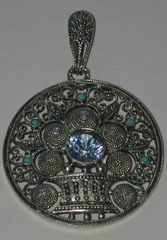 Theodore Fahrner Art Deco Flower Basket Pendant Fun late twenties, early thirties Fahrner flower basket pendant set with a blue topaz paste, marcasites, and turquoise and accented with delicate filigree.