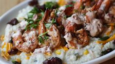BBQ'd shrimp w/ thick house bacon, cheddar, and scallions on a bed a creamy stone ground grits & chipotle cream at Bone Lick BBQ